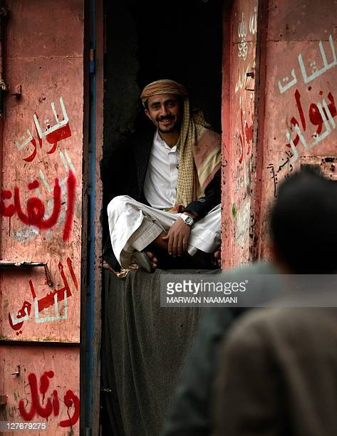A Yemeni sits in the doorway of his shop which sells qat the narcotic leaves of an evergreen shrub in a street in Sanaa January 25 2010 The United...