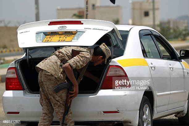 A Yemeni soldier checks a vehicle at a checkpoint in the capital Sanaa on May 12 one day after in an attack on a military base by a suspected AlQaeda...