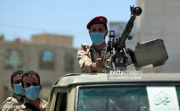 Yemeni soldier loyal to the Huthi rebels mans a machine gun turret in the back of a pickup truck during a patrol in the capital Sanaa on March 23,...