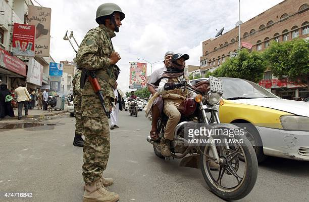 A Yemeni soldier loyal to the Huthi Shiite militia patrols vehicles at a street in the capital Sanaa on May 25 2015 Rebel forces and loyalist...