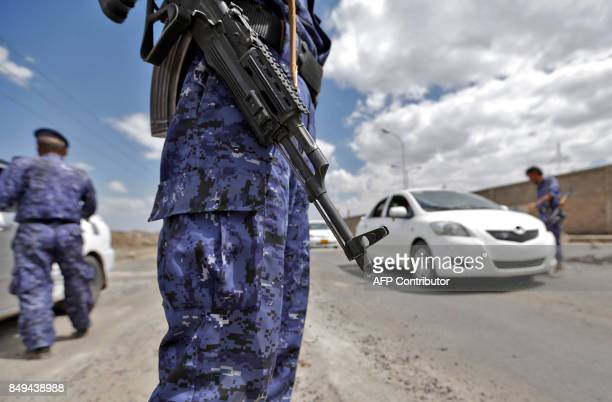 A Yemeni soldier loyal to the Iranbacked Shiite Huthi rebels slings a Kalashnikov assault rifle while manning a checkpoint as the rebels tighten...