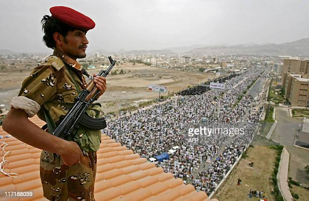 A Yemeni soldier stands guard as antigovernment protesters gather for a rally in Sanaa on June 24 2011 to demand the formation of an interim ruling...