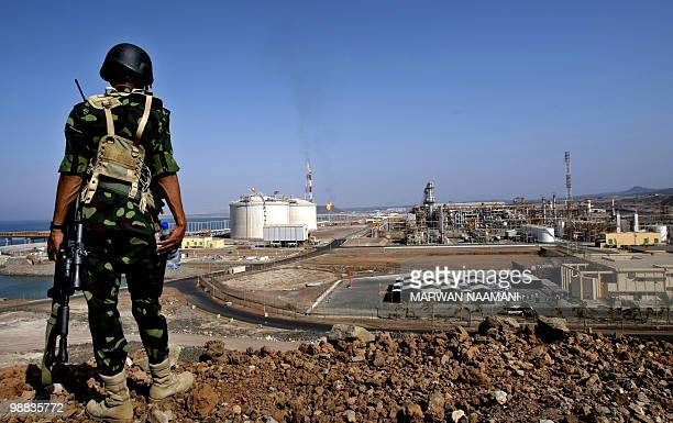A Yemeni soldier stands guard at the newly built liquefied natural gas plant in Balhaf on the Gulf of Aden on November 7 2009 Yemen began exporting...