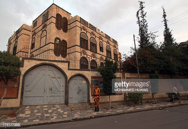 A Yemeni soldier stands guard in front of the Iranian embassy in Sanaa on July 21 as authorities tighten security measures after gunmen suspected of...