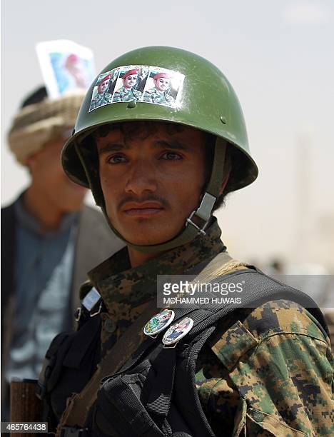 A Yemeni soldier stands outside the house of Ahmed Ali Abdullah Saleh the son of Yemen's former president Ali Abdullah Saleh who stepped down in...