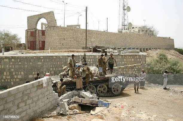 Yemeni soldiers and local tribes men gather around a tank on June 13 after the army seized the AlQaeda strongholds of Jaar and the provincial capital...