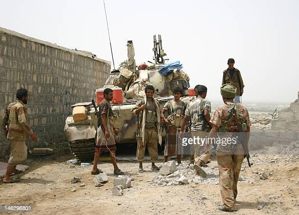 Yemeni soldiers and local tribes men gather on June 13 after the army seized the AlQaeda strongholds of Jaar and the provincial capital Zinjibar on...
