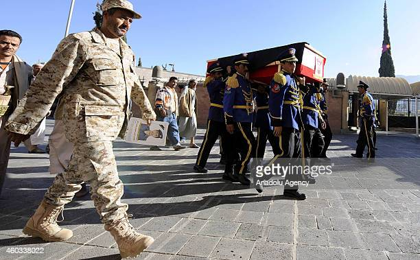 Yemeni soldiers carry the coffins of 7 of the soldiers killed in recent Hadhramaut attack during their funeral ceremony at Shuhada Mosque in Sanaa...