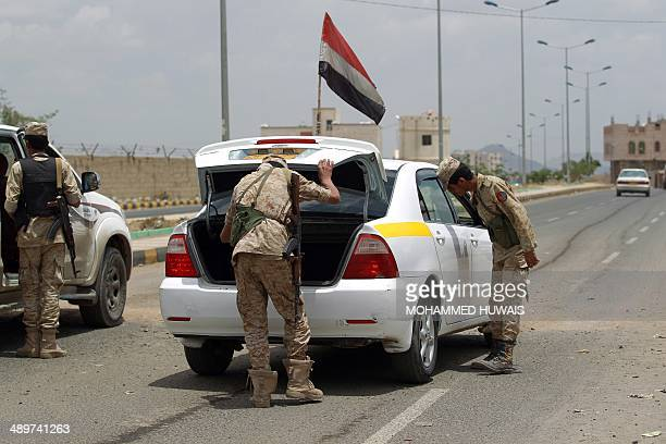 Yemeni soldiers check a vehicle at a checkpoint in the capital Sanaa on May 12 one day after in an attack on a military base by a suspected AlQaeda...