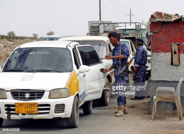 Yemeni soldiers loyal to the Iranbacked Shiite Huthi rebels stop cars at a security checkpoint as the rebels tighten security measures in Sanaa on...