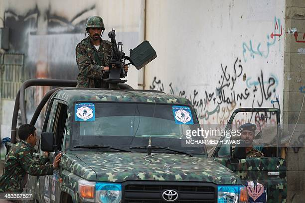 Yemeni soldiers man a checkpoint in the capital Sanaa on April 8 after suspected AlQaeda militants in police uniforms killed four soldiers in an...