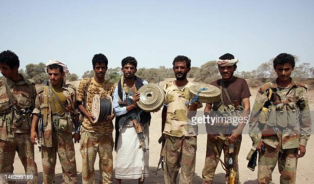 Yemeni soldiers pose with munition they found on June 13 after the army seized the AlQaeda strongholds of Jaar and the provincial capital Zinjibar on...