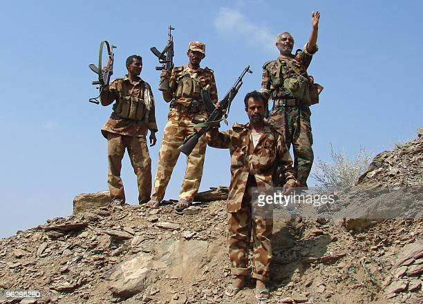 Yemeni soldiers raise their weapons at an area in the northwest Saada province where they are battling Shiite Huthi rebels on January 31, 2010. Yemen...
