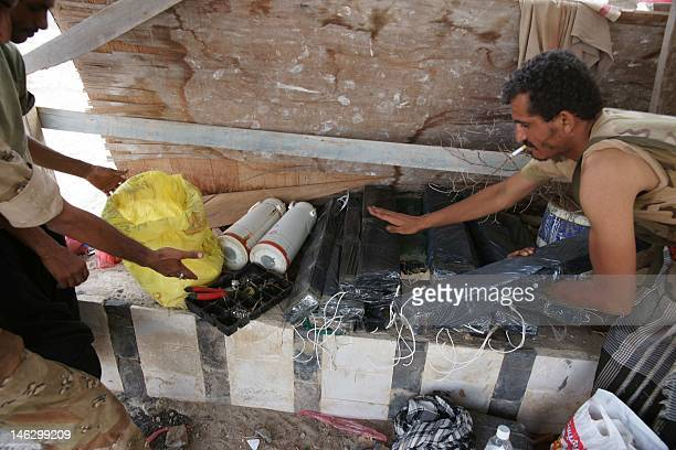 Yemeni soldiers remove ammunition they found on June 13 after the army seized the AlQaeda strongholds of Jaar and the provincial capital Zinjibar on...