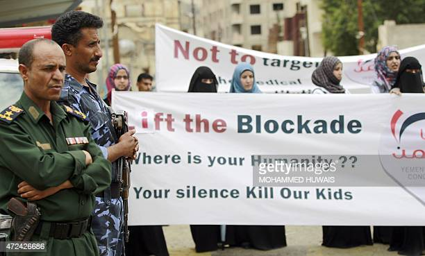 Yemeni soldiers stand by during a protest by medical staff outside the headquarters of the United Nations against a blockade imposed on the country...