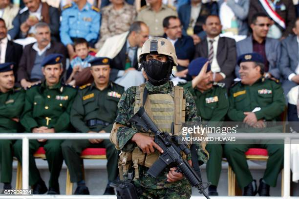 Yemeni soldiers stand guard during a rally to mark two years of the military intervention by the Saudiled coalition in the capital Sanaa on March 26...