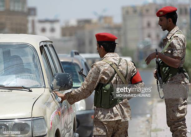 Yemeni soldiers stand guard in the capital Sanaa on April 20 as they check passing vehicles as authorities tightened security measures a day after a...