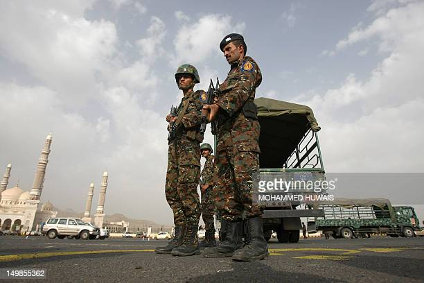 Yemeni soldiers stand guard outside the alSaleh mosque during a memorial service to commemorate the victims of a suicide bombing in Abyan province on...