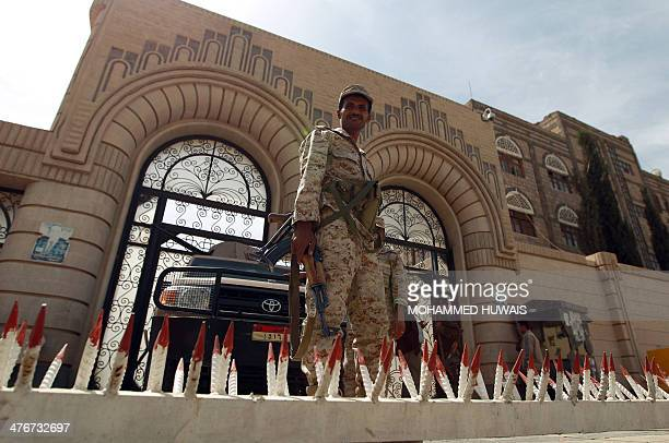 Yemeni soldiers stand guard outside the cabinet headquarters during the weekly parliament session with Yemeni ministers in Sanaa on March 5 2014...