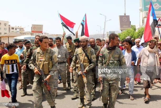 Yemeni Southern separatists supporters wave flags of the former South Yemen as they demonstrate in the Khor Maksar district of Yemen's second city of...