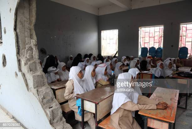 Yemeni students study in a classroom in the Yemeni port city of Hodeidah on March 15 which was damaged in the country's ongoing conflict between the...