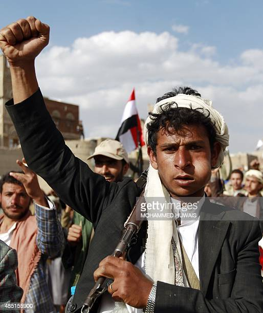 A Yemeni supporter of the Shiite Huthi rebel movement chews Qat a mild drug used daily by many Yemenis while attending rally to protest against a...