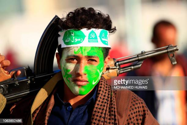 Yemeni supporter to the Shiite Huthi movement attends a rally marking the birth anniversary of Islam's Prophet Mohammad in the capital Sanaa on...
