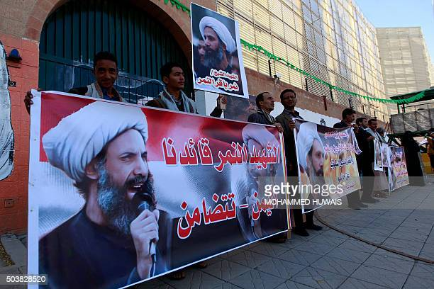 Yemeni supporters of Iranbacked Shiite Huthi rebels hold banners bearing portraits of prominent Shiite cleric Nimr alNimr during a demonstration on...