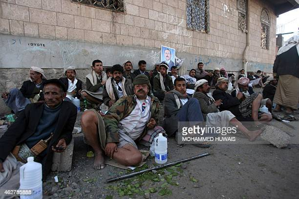 Yemeni supporters of outgoing President Ali Abdullah Saleh block the entrance to the stateowned alThawra daily in Sanaa on February 2 2012 Gunmen...