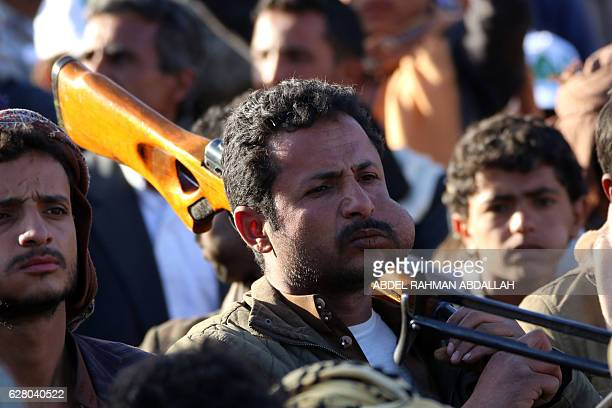 Yemeni supporters of Shiite Huthi rebels demonstrate to support the new government that they formed on December 6 2016 in the capital Sanaa Yemen's...