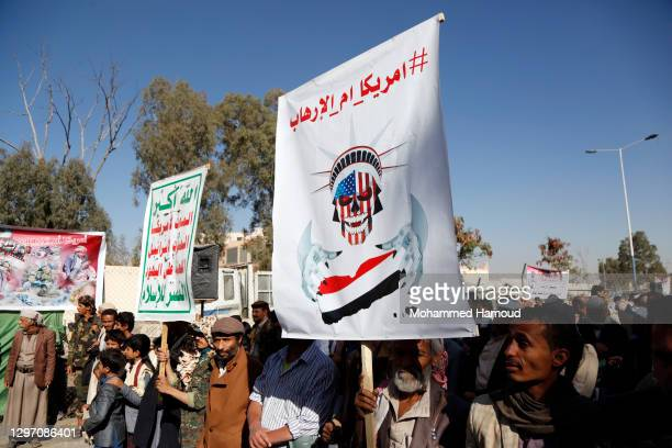 Yemeni supporters of the Houthi group protest to reject the Trump administration decision to designate the Houthis, known as Ansar Allah, a terrorist...