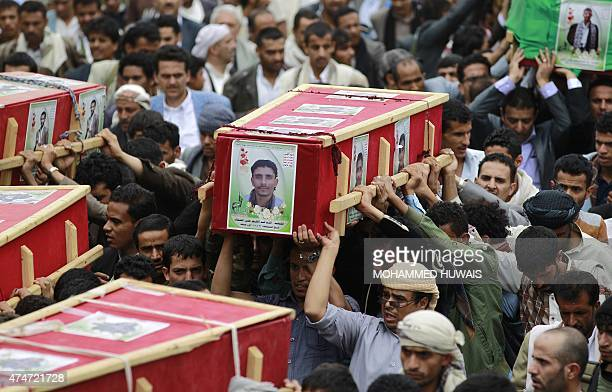 Yemeni supporters of the Huthi Shiite militia carry on May 25 2015 coffins of people reported killed in air strikes carried out by the Saudiled...