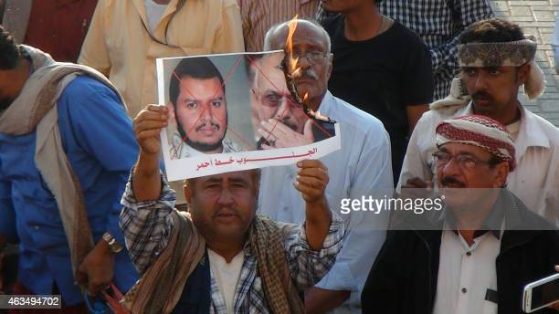 Yemeni supporters of the separatist Southern Movement burn a portrait of the Shiite Huthi movement's leader AbdulMalik alHuthi and toppled president...