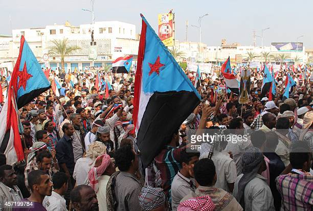Yemeni supporters of the separatist Southern Movement shout slogans demanding independence from the north during a demonstration on October 14 2014...
