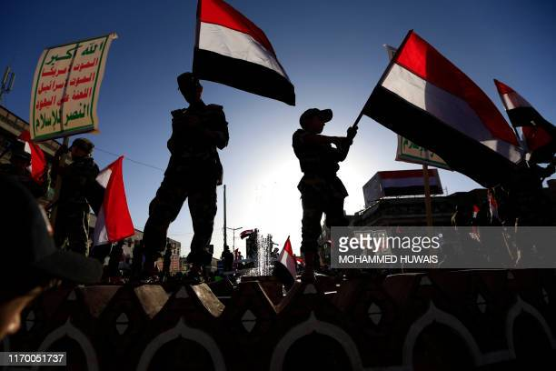 Yemeni supporters of the Shiite Huthi movement take part in a rally to commemorate the fifth anniversary of the Huthi takeover of the capital Sanaa...
