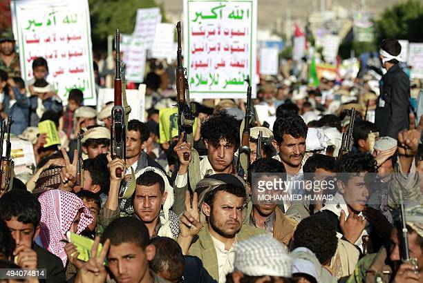 Yemeni supporters of the Shiite Huthi rebel movement raise their weapons as they demonstrate against Saudiled coalitions airstrikes following a...