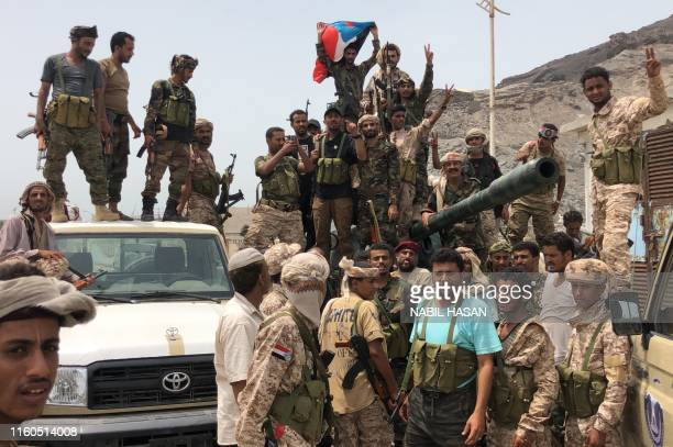 Yemeni supporters of the southern separatist movement pose for a picture in Khor Maksar, in the Yemeni southern port city of Aden on August 10, 2019....