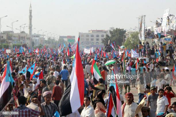 Yemeni supporters of the southern separatist movement wave the movement's flag during a rally calling for independence of the south in the country's...