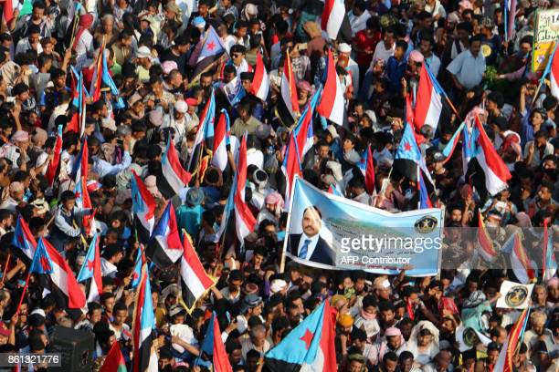 Yemeni supporters of the southern separatist movement wave the movement's flag during a rally in the southern port city of Aden on October 14 2017 /...