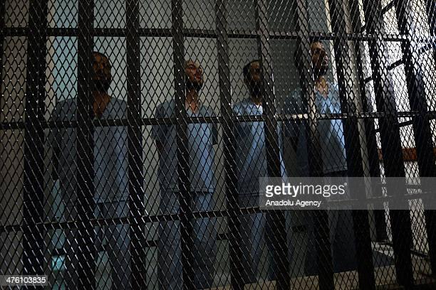 Yemeni suspected alQaeda militants Husain Salem alAgili Husain Saleh Abd Rabbu Yousef Saleh Abd Rabbu Sha'aif Abdu Mohammed alHaimi stand behind bars...