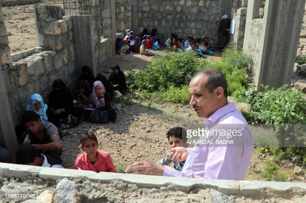 Yemeni teacher gives an open-air class at an unfinished school on September 16, 2019 in the southwestern Yemeni village of al-Kashar in Taez...