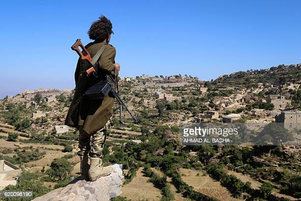 Yemeni tribesman from the Popular Resistance Committee, supporting forces loyal to Yemen's Saudi-backed President Abedrabbo Mansour Hadi, stands on...