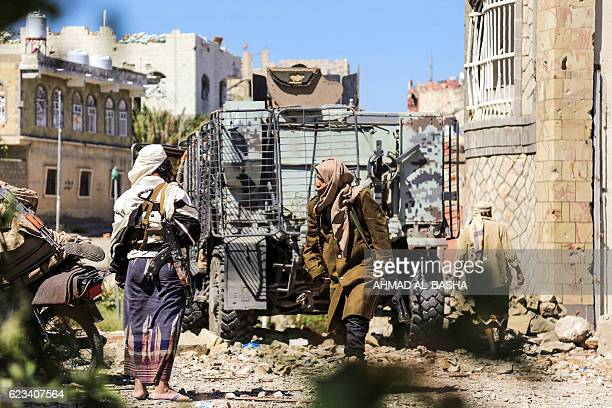 Yemeni tribesman from the Popular Resistance Committee, supporting forces loyal to Yemen's Saudi-backed President Abedrabbo Mansour Hadi, holds a...