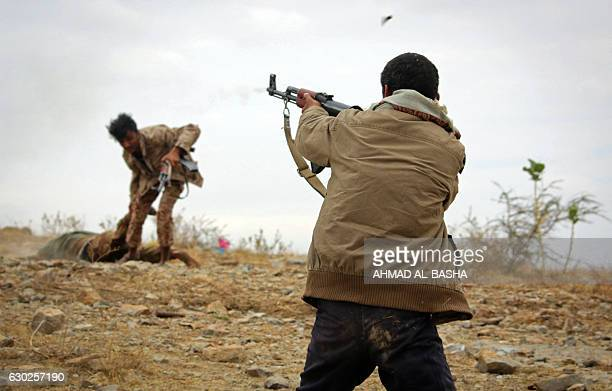 Yemeni tribesman from the Popular Resistance Committee supporting forces loyal to Yemen's Saudibacked President Abedrabbo Mansour Hadi fires a weapon...