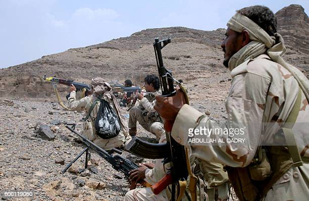 Yemeni tribesman from the Popular Resistance Committees supporting forces loyal to Yemen's Saudibacked President aim their weapons as they hold a...