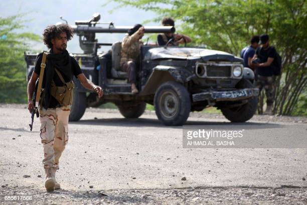 Yemeni tribesmen from the Popular Resistance Committee supporting forces loyal to Yemen's Saudibacked President Abedrabbo Mansour Hadi guard a...