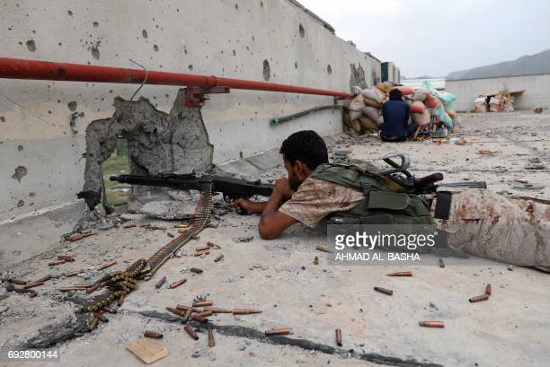TOPSHOT Yemeni tribesmen from the Popular Resistance Committee supporting forces loyal to Yemen's Saudibacked President Abedrabbo Mansour Hadi hold a...