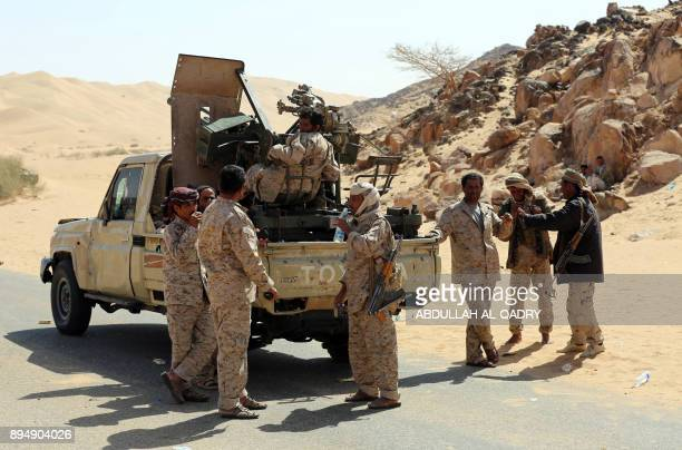 Yemeni tribesmen from the Popular Resistance Committees loyal to Yemen's Saudibacked President disembark from a pickup truck carrying an antiaircraft...