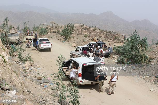 Yemeni tribesmen from the Popular Resistance Committees, supporting forces loyal to the country's exiled president, gather on a road near the village...