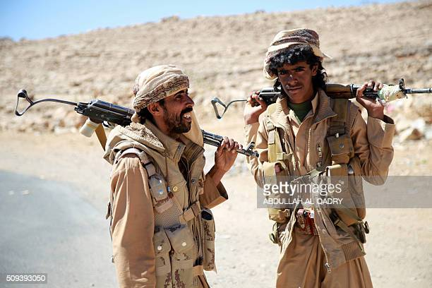 Yemeni tribesmen from the Popular Resistance Committees supporting forces loyal to Yemen's Saudibacked President talk as they prepare to launch...